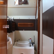 Aft head with shower and black water tank