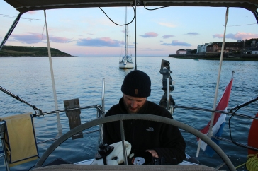 Thomas servicing the outboard during an idyllic sunset